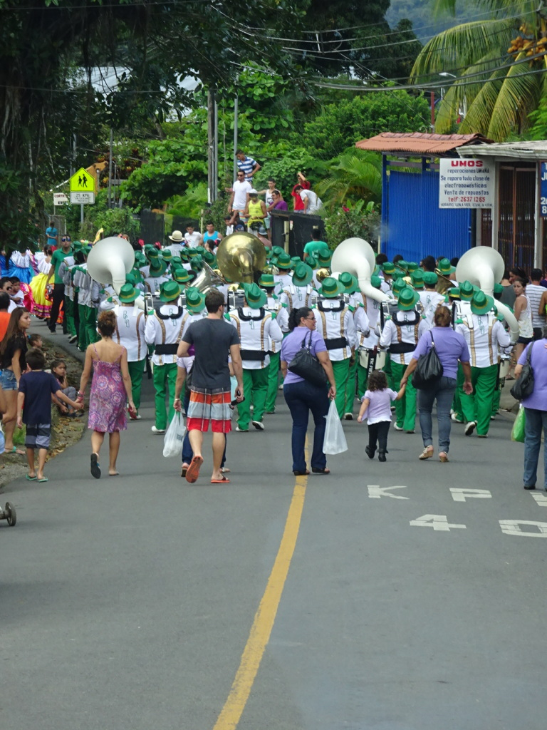 The bus turned down a little road and there was a parade in full swing! We had to back up and take a different way.