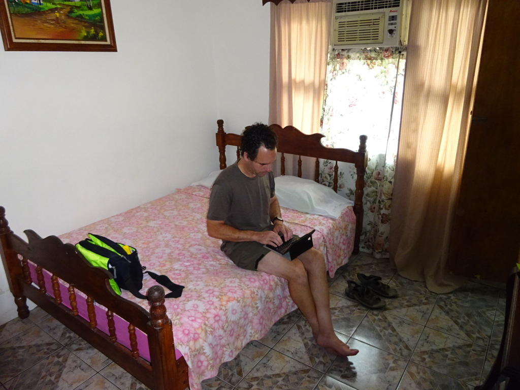 This is the room we rented from Edith. Aaron is sitting in the air conditioning.  Ahhhh....