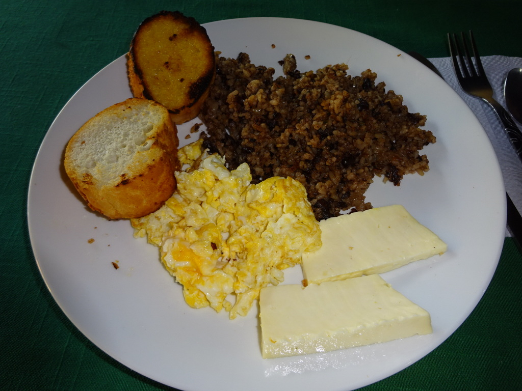 This is a typical Costa Rican breakfast: rice & beans, scrambled eggs, toast, and cheese or meat - like chicken.