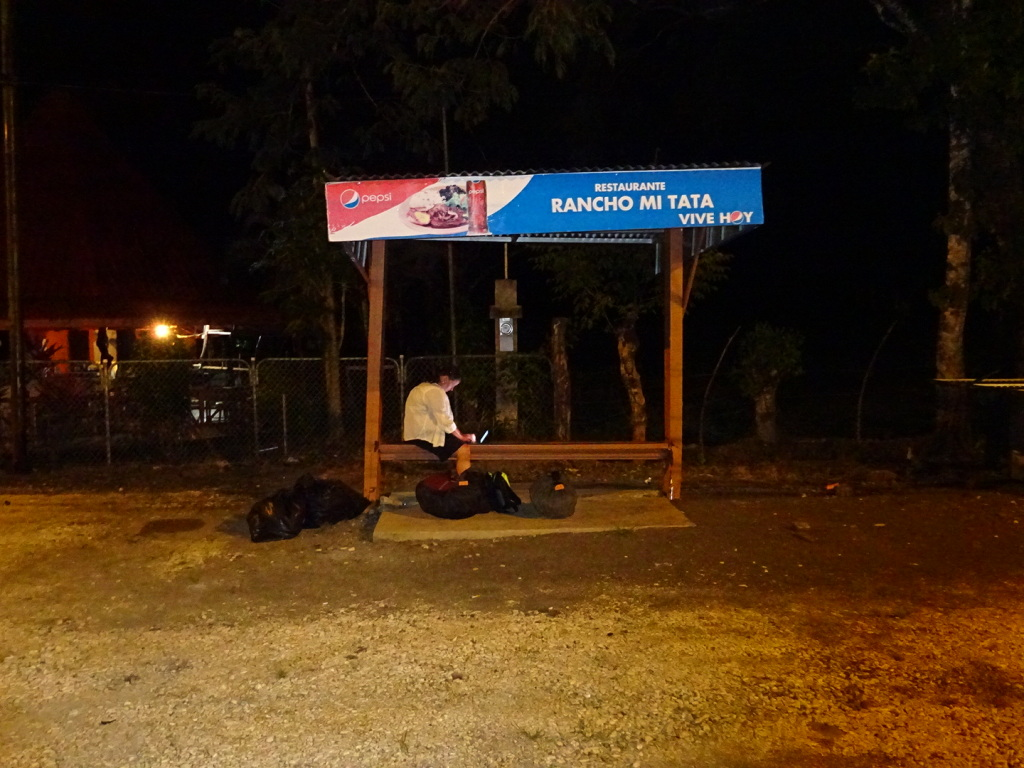 Well into the small hours - Anner waits at the side of the road for the Tica Bus (and blogs).