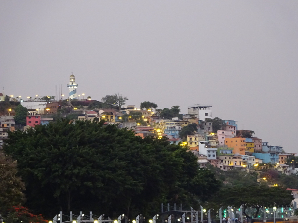 View of the Santa Ana neighborhood and lighthouse at one end of the Malecon.