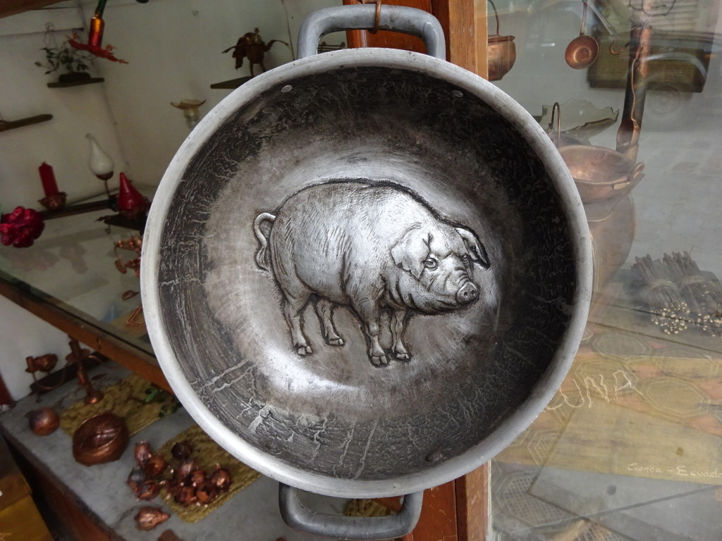 Chased pig on a serving/cooking pot.