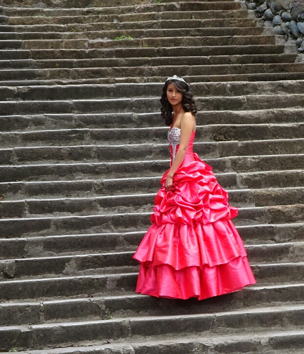 Getting photographed for her quincenera.