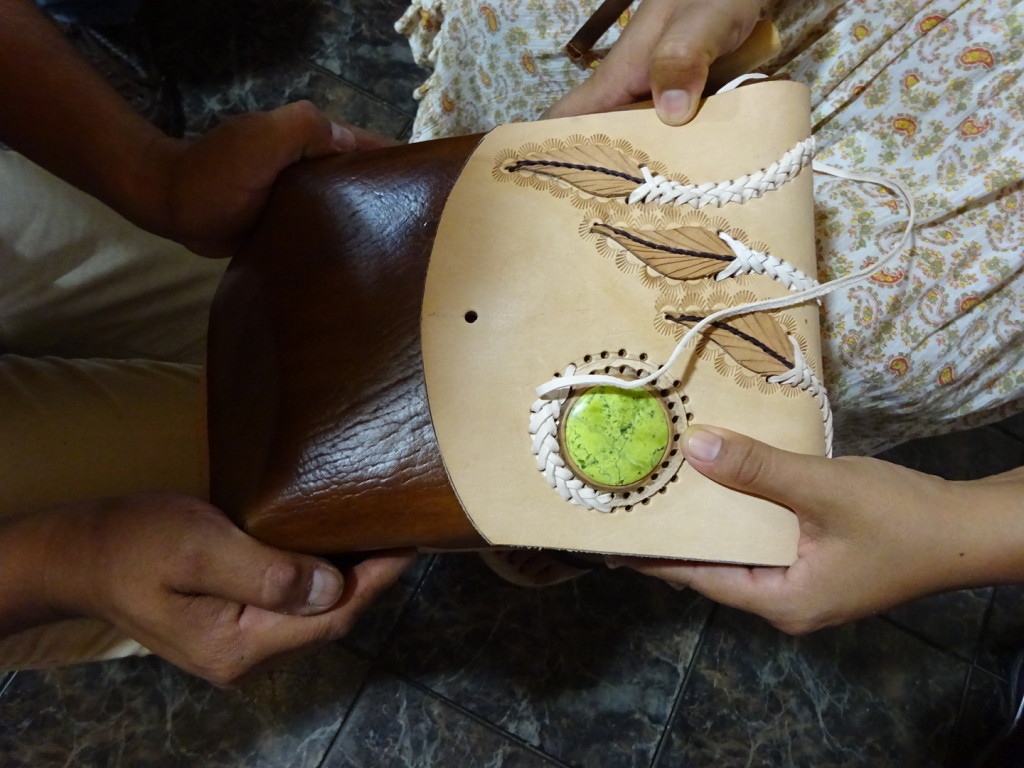 A leather bag in process - you can see the dyed leather of the bag. The flap hasn't been dyed yet.