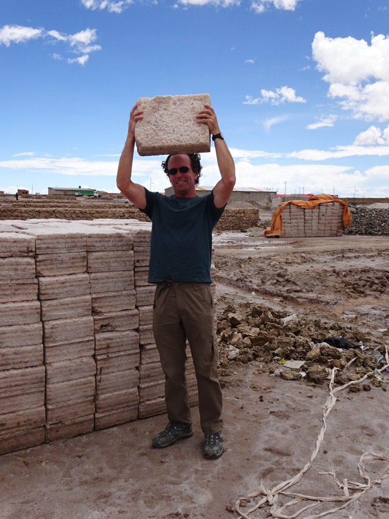 Aaron holding a very heavy block of salt. Used like bricks to build structures and homes in the area.