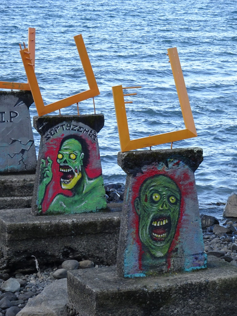Then, across the street, there were these fellows painted onto the remains of an old pier. Their expressions have nothing to do with their opinions of the exhibition, I'm sure.