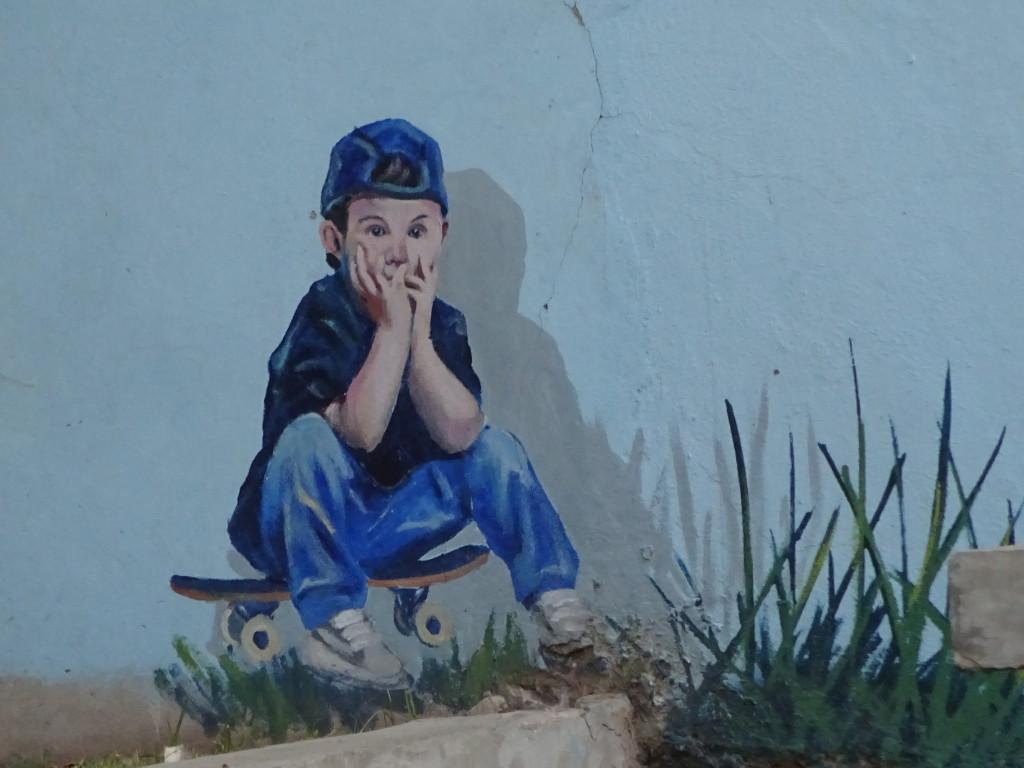 Detail of Martin Ron's mural - this boy came by to watch while Martin was painting, so he just added the boy in! Those are the kind of stories we heard on the tour that we would never have known on our own!