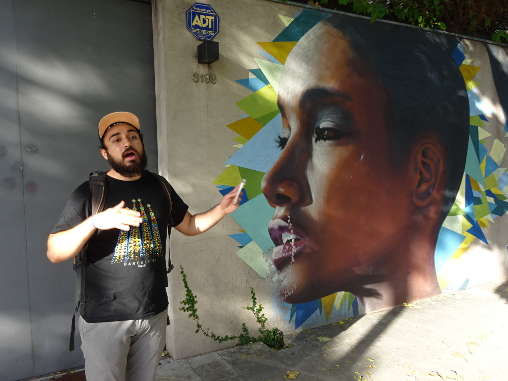 Ollie with a painting by Primos, a pair of cousins who paint mostly faces of black Argentinians for their beauty and as a statement on the slavery many were put under.