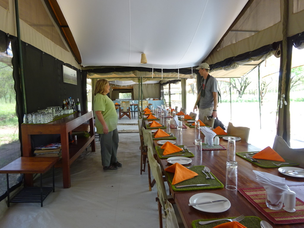 Long dinner table with view of the bush.