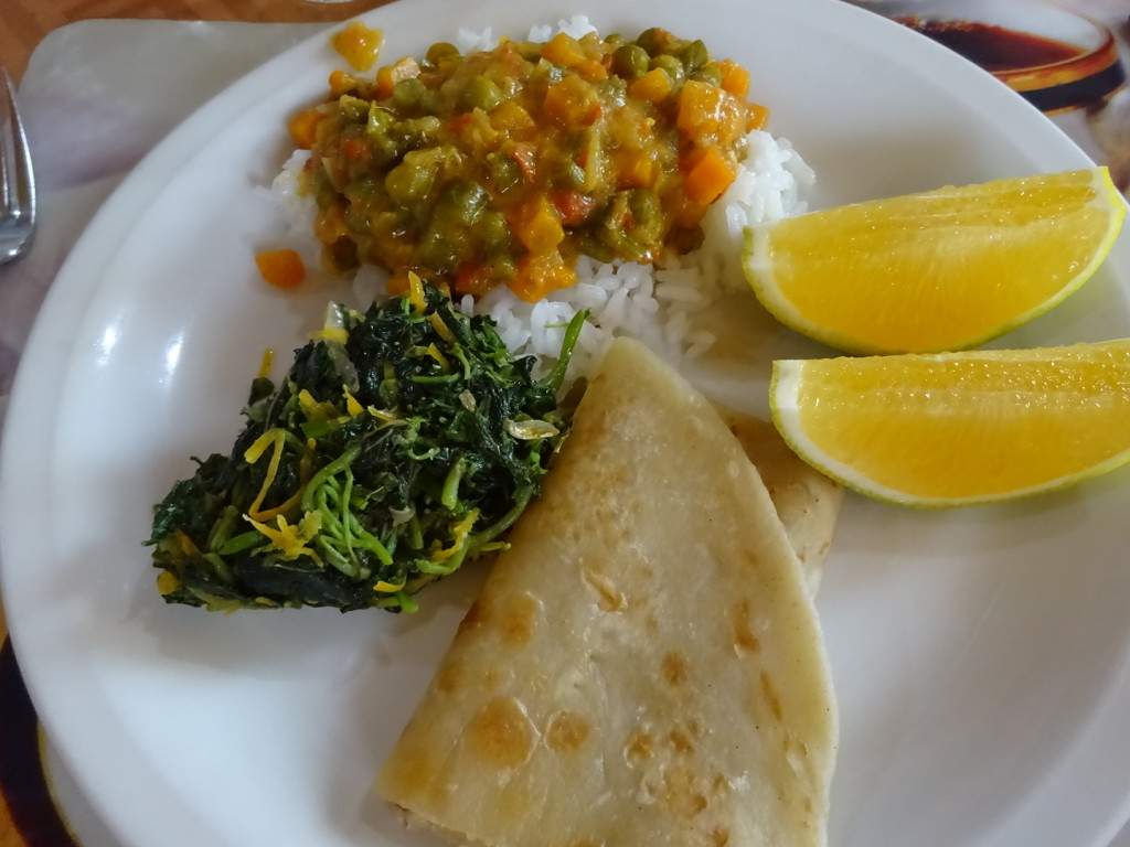Lunch Time! Veggie curry, rice, greens, chipati and oranges.