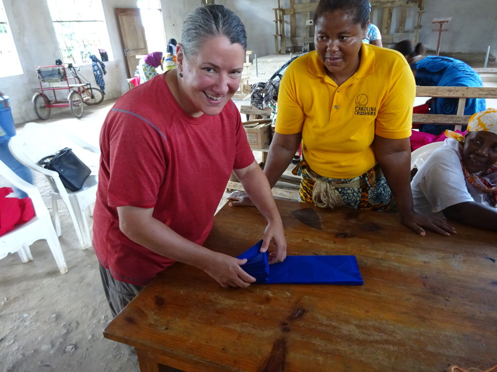 "Anner get a lesson in fabric folding. The triangle is called ""sambusa"" after a triangle shapped food here in TZ."
