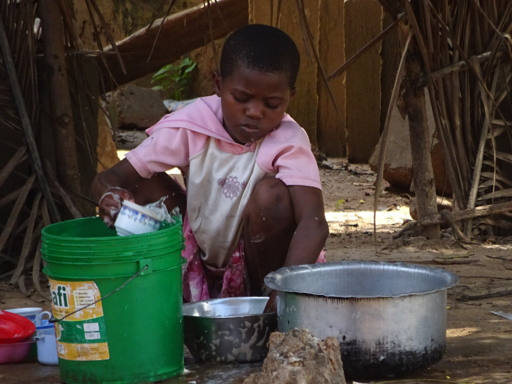 Amboni is this kind of poor. This girl washes dishes instead of going to school. Moment earlier she was using a knife the size of her arm to peel vegetable with incredible speed.