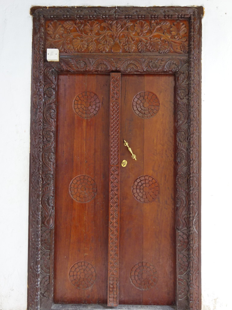 Some doors had the door itself and handle modernized, but kept the original carved frames.