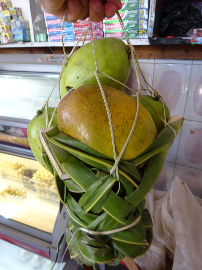 Mangos in a cool, handmade basket.