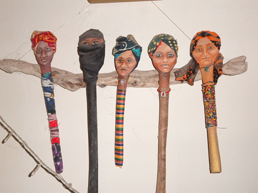 Wooden spoons turned art dolls. They represent the women of Zanzibar.