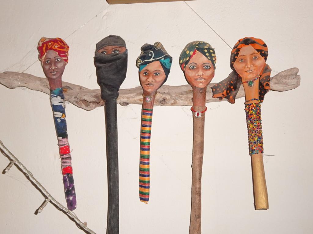 Wooden spoons turned art dolls. They represent the women of Zanzibar.