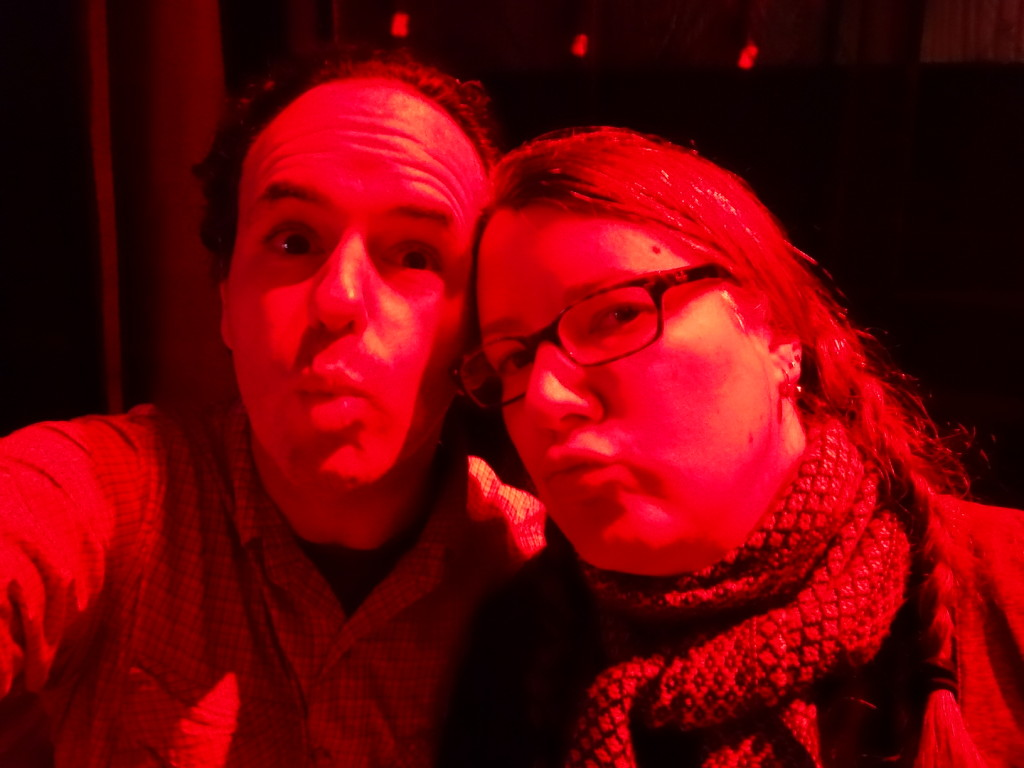 Making duck faces in the red lights.