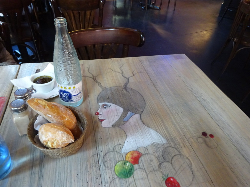 Love to see restaurants getting in on the urban art scene - wonderful tables!