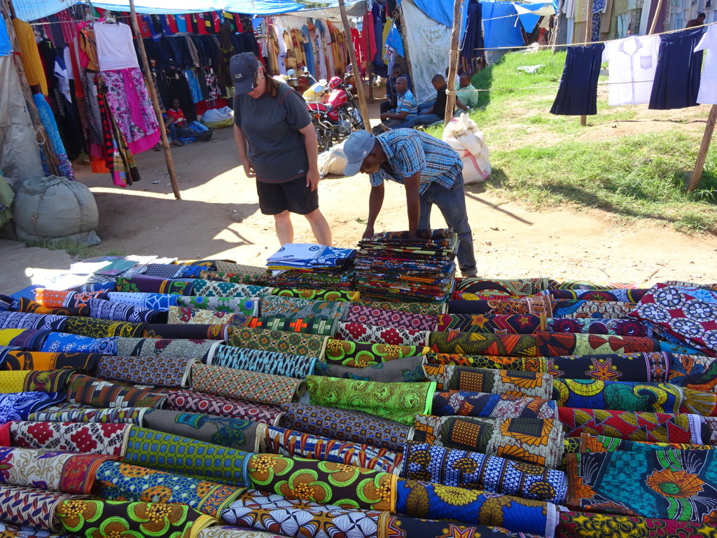 Picking out fabrics in Tanzania. This was a market in Tanga.
