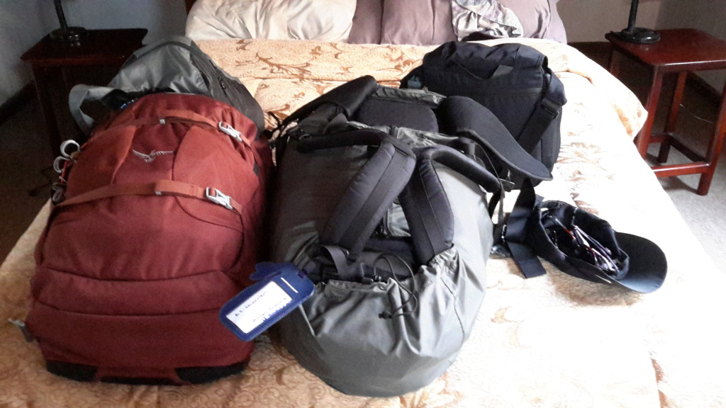 Pack 'er up!! Heading to a bus or train on this day.