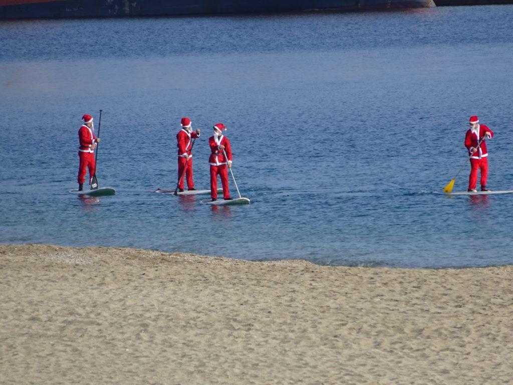 We saw the paddle boarding santas. Hola Santa!