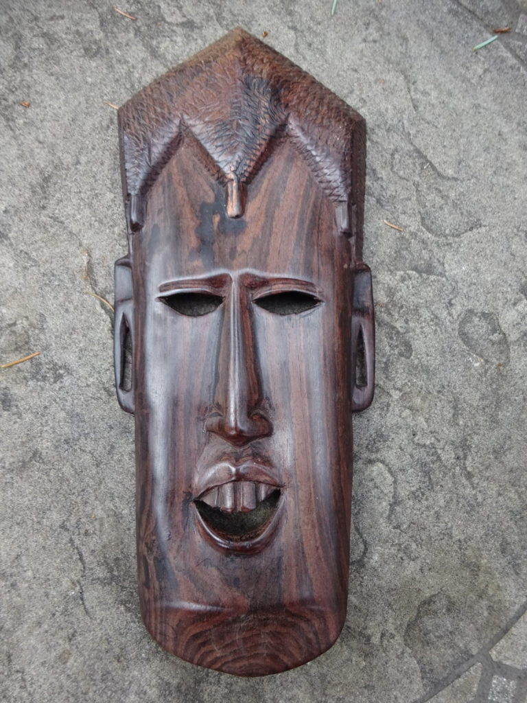 It's an unbelievably cool mask carved by non other than Cockroach.