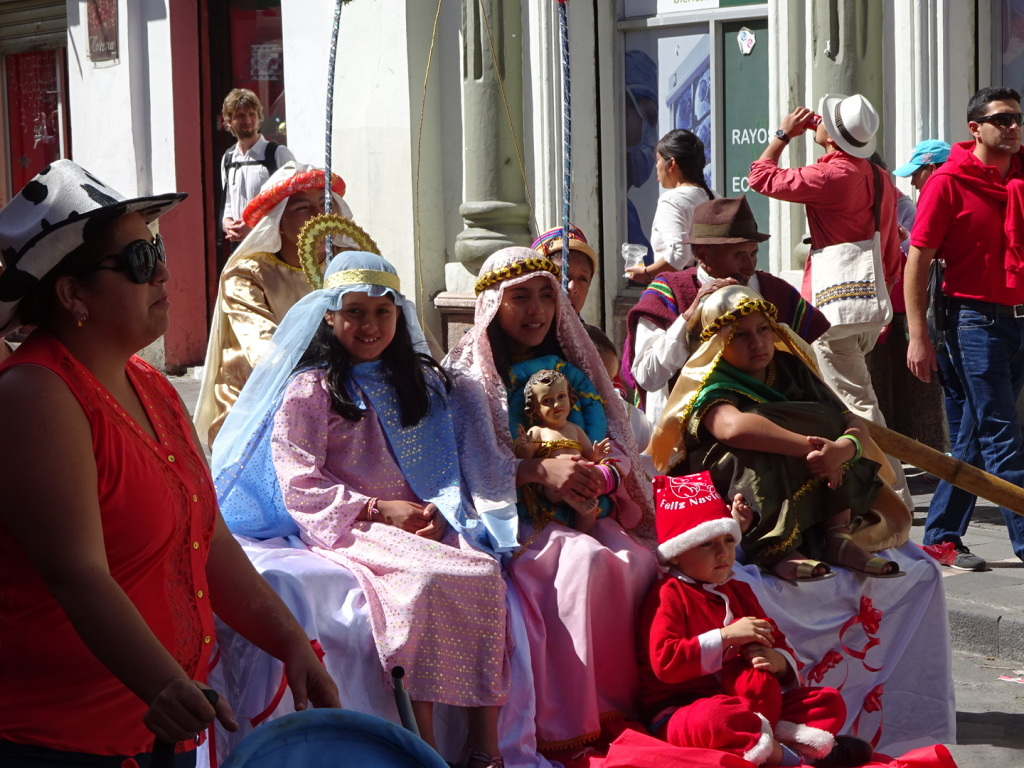 Parade participants with their baby jesus.