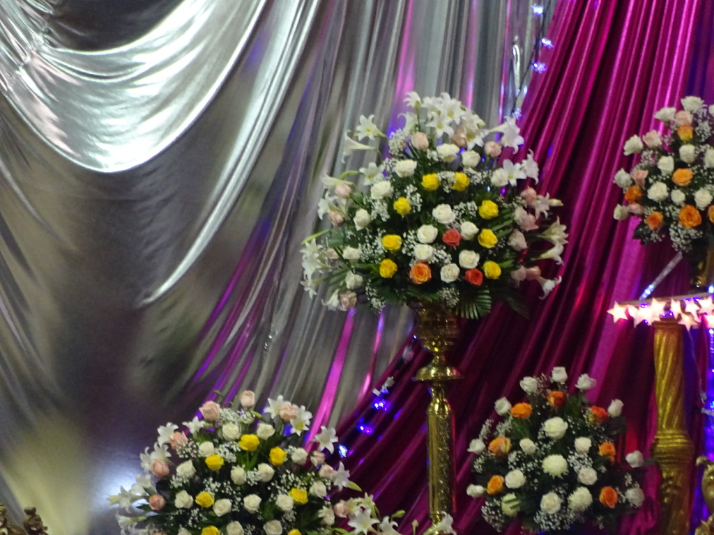 The flowers and light-up stars on the alter.