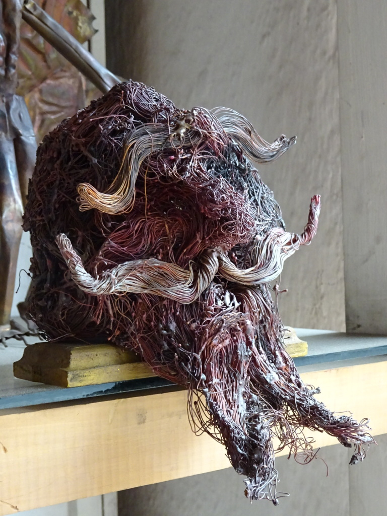 This face sculpture is 100% recyled copper wires.