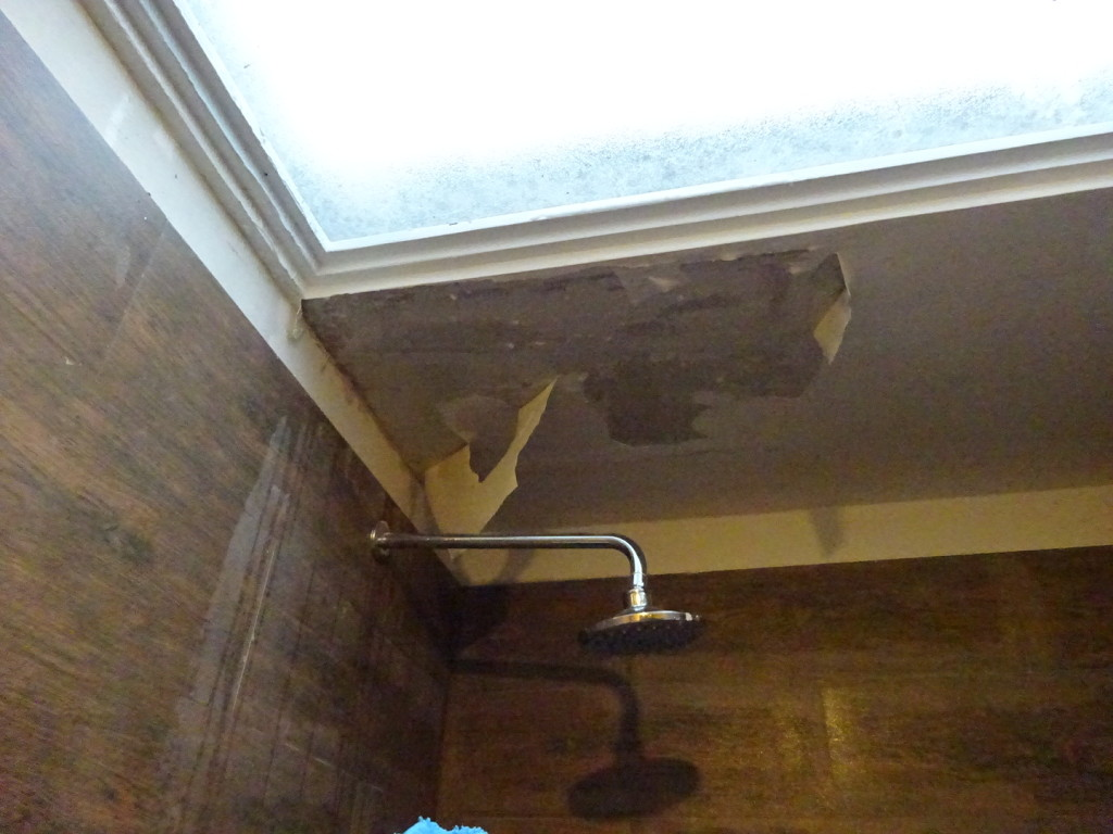 The start of the ceiling coming down.  By the time it caved in, I had the camera packed and was ready to go.