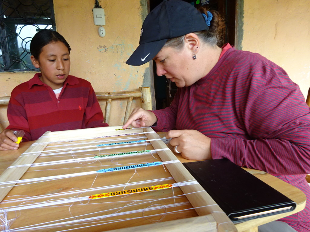 Samual teaching me how to do beeding. Yet another thing that is harder than it looks.  You can see our tablet is out...that is because we have a translation app on it and occassionally we would type a word in so we could continue with our lessons.