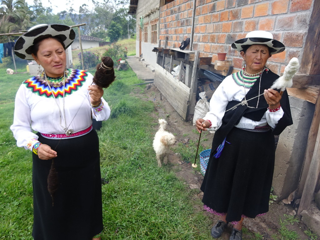 Luiza and Abellina pulling yarn from cleaned wool. The white and dark are both natural colors from different types of sheep.