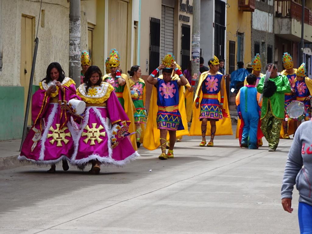 Performers finsih the parade.