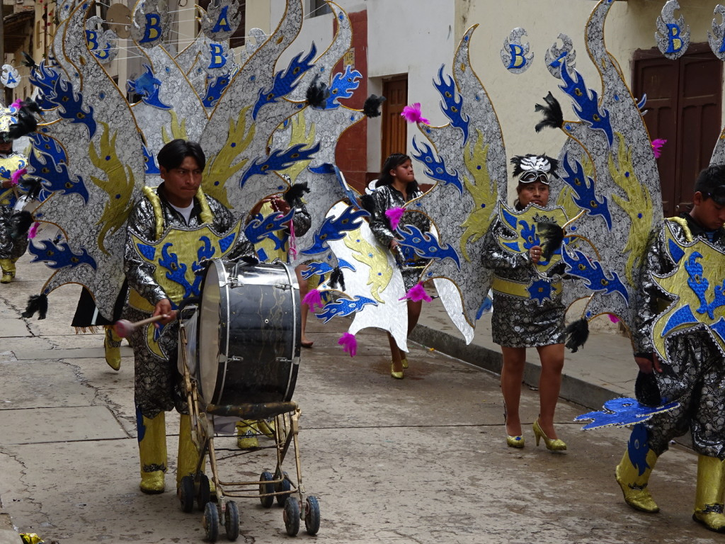 """Strollers are a rare site in South America. Babies and Kids are carried on their parents backs or in their arms (big kids, we couldn't carry down the block!). """"Sidewalks"""" have steps, holes, and trash in them. Turns out, strollers don't make sense. Strollers are for carring drums during the parade!"""