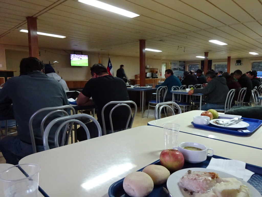 Dining Hall - see everyone is sitting in rows watching the futbol match!