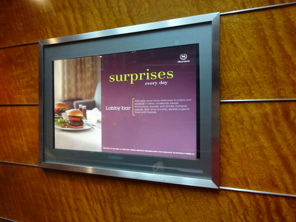 """The first sign we saw in our lay-over hotel, """"Surprises!"""" We had quite a surprise, in deed!"""