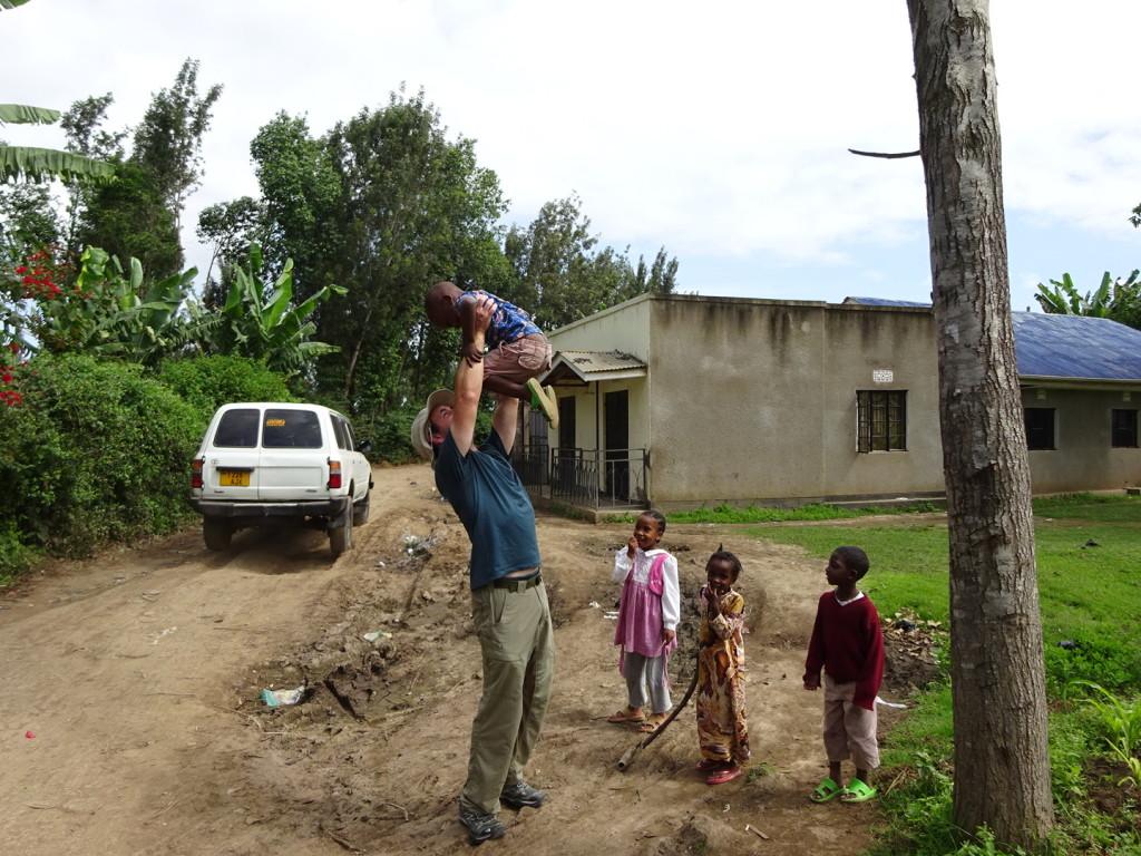Aaron greeted by village children