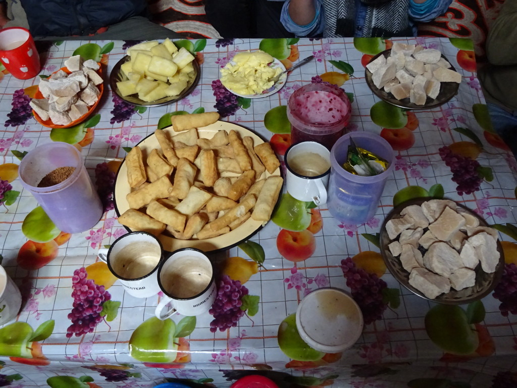 Fried dough in the middle, dried yogurt in the corners and yak milk cheese 2nd from the top left - breakfast of kings! Well, plus porridge.