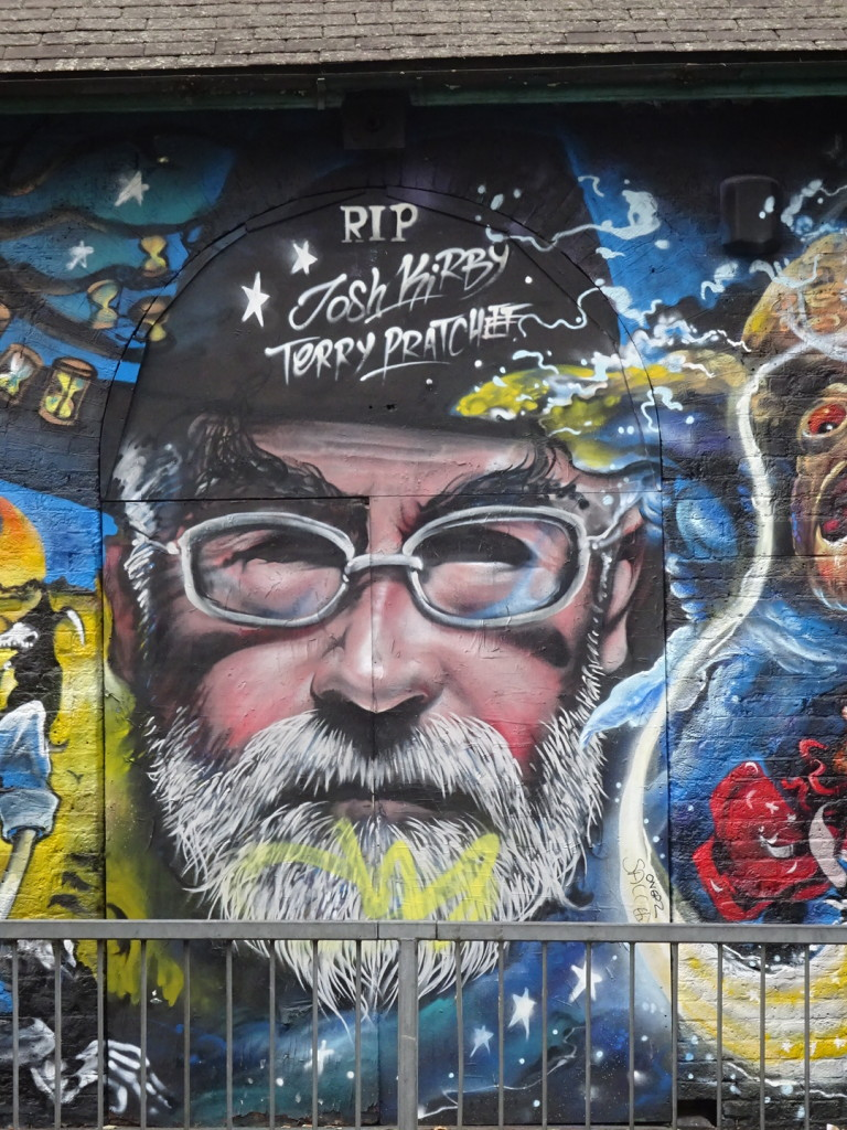 This was just one small part of a blocks-long mural, but I had actually been reading a Terry Pratchett novel at the time, so I had to take the shot.