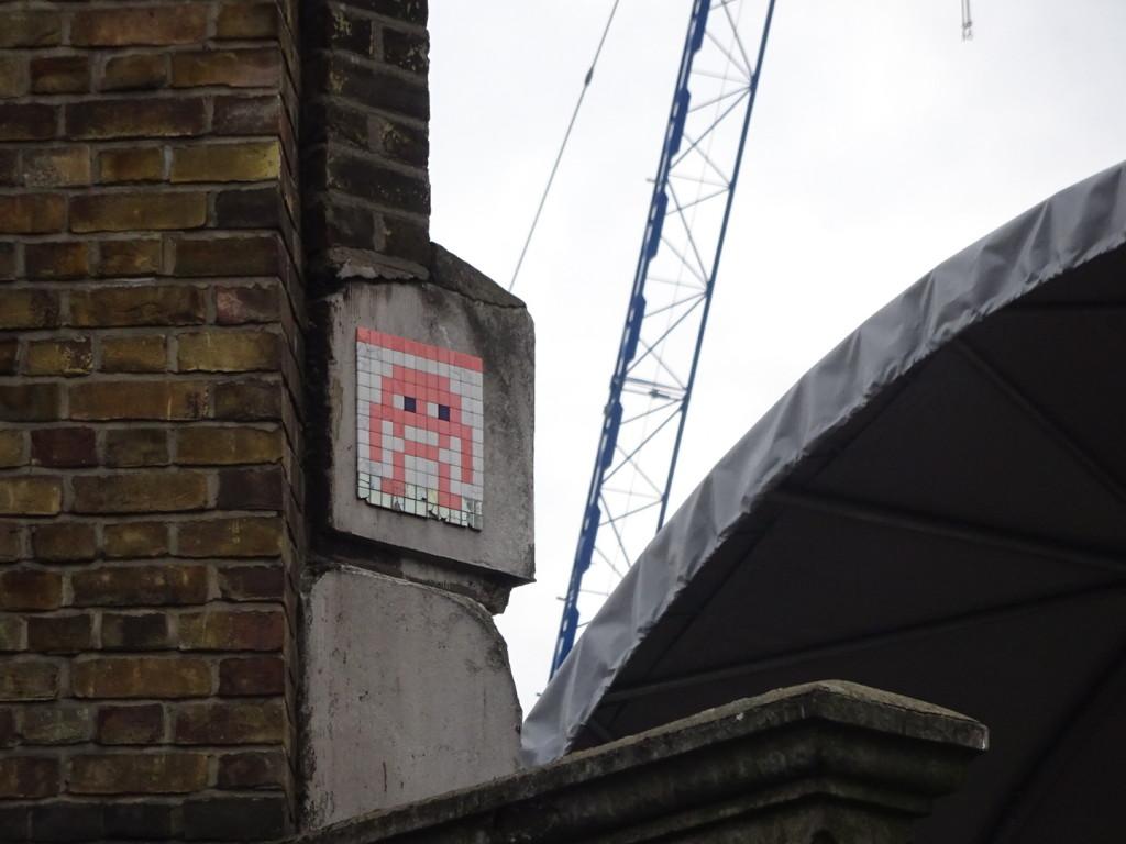 An Invader high on a wall...