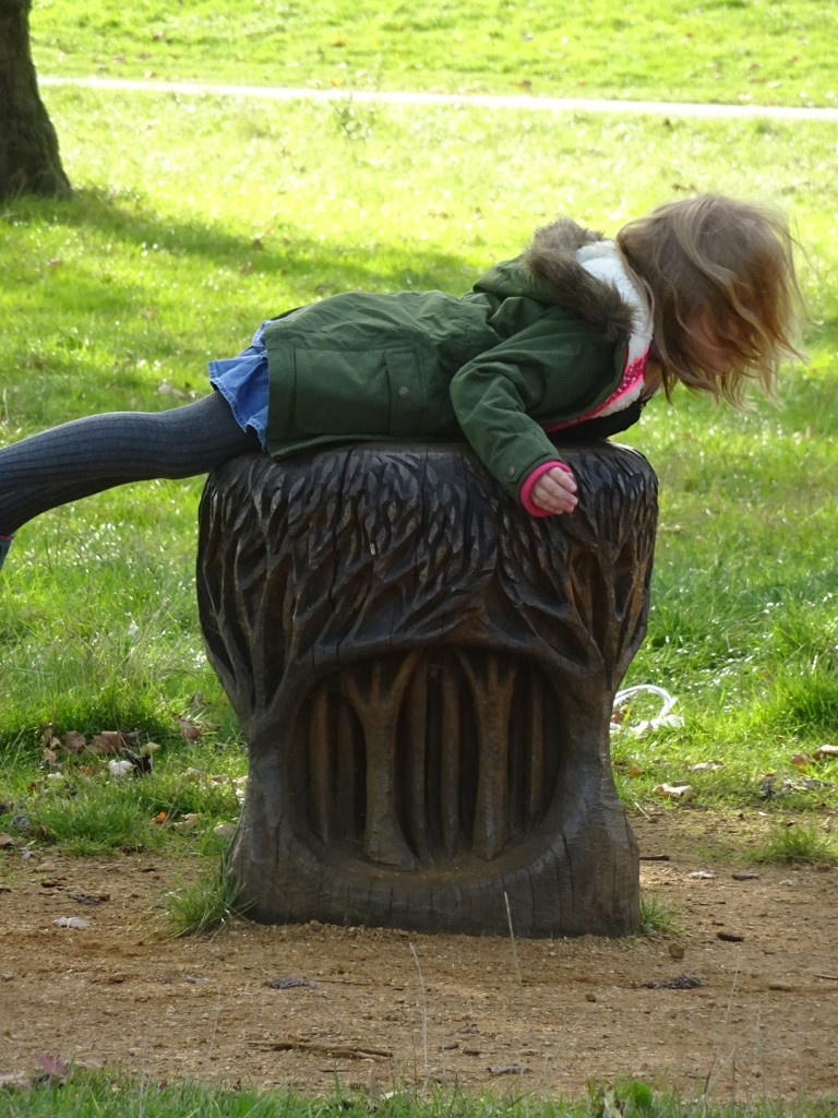 Fun sculpture tables and stools at the park on a sunny fall day (I think it was Regent's, but it might have been Primrose Hill). Doesn't get any better and this youngster knew it.