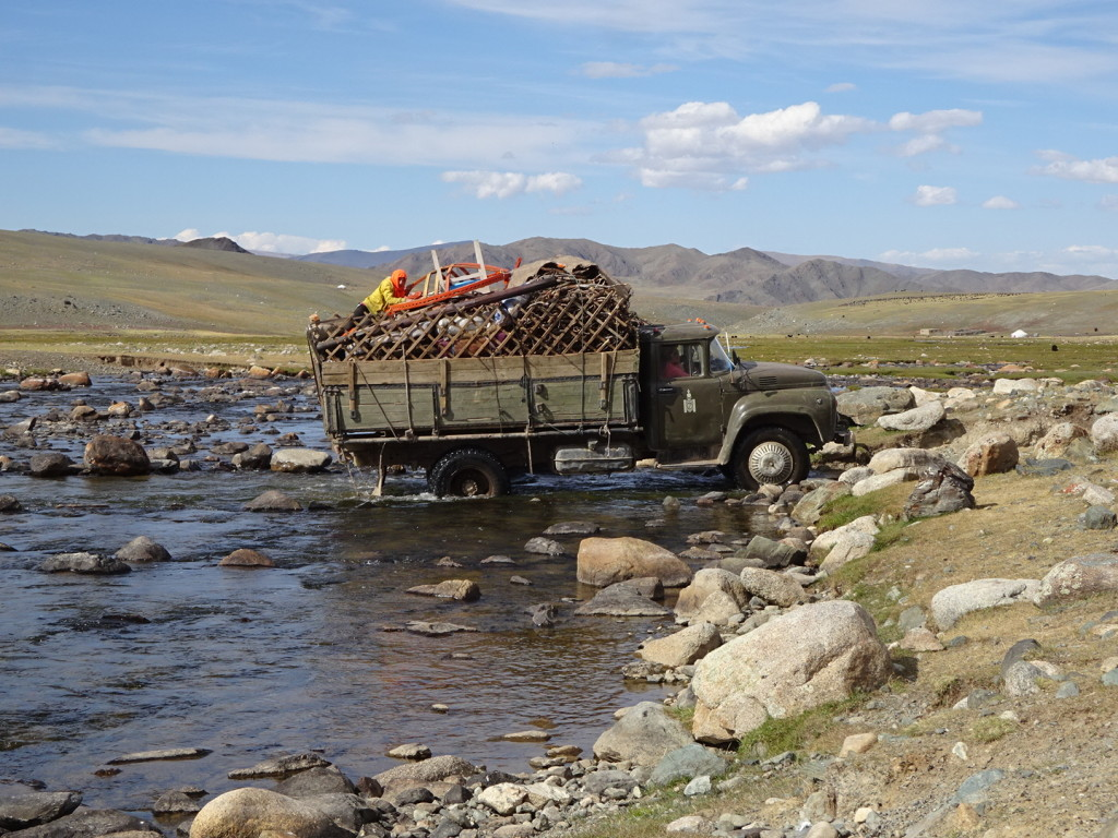 Love, love, love this pic - moving day in Mongolia. Khazaks move about every three months. Alti Mountains, Mongolia.