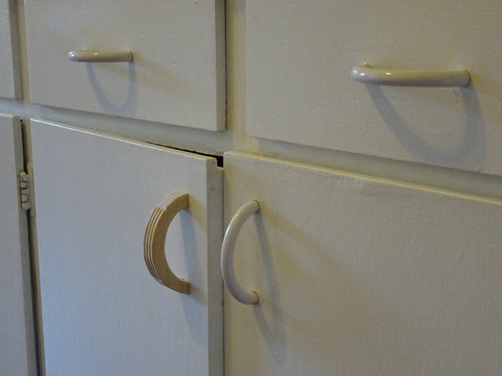 Perhaps a little nicer than our cheap, plastic handles...even if it doesn't match the white very well?